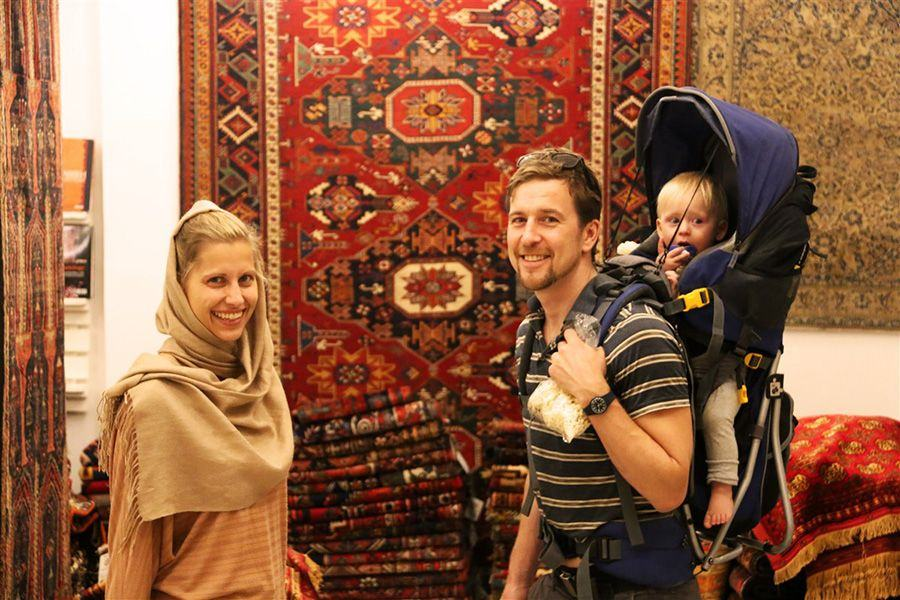 A traveler couple visiting Iran with their child