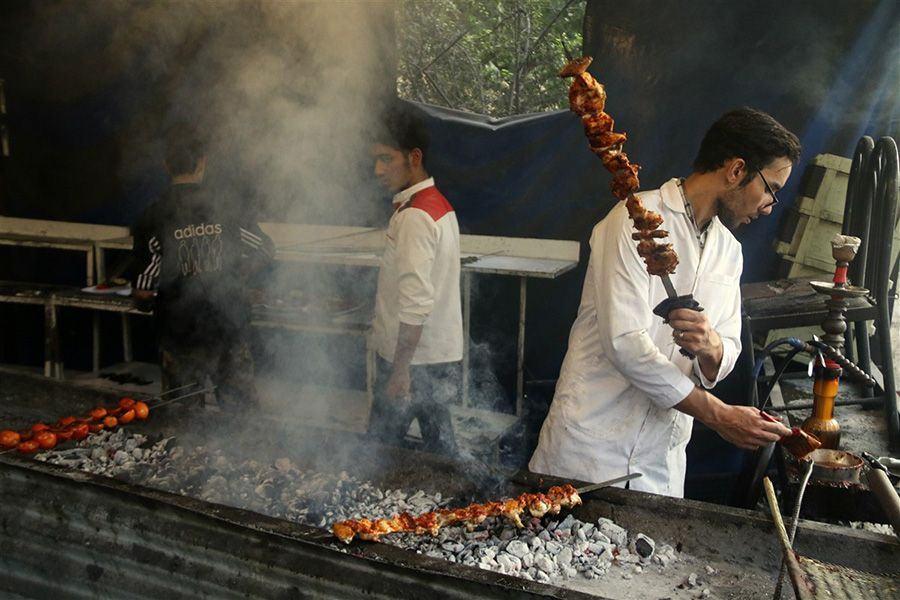 Young men barbequing Kebabs in Iran