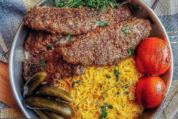 Iranian Kebab Tabeh or pan kebab with rice and tomato