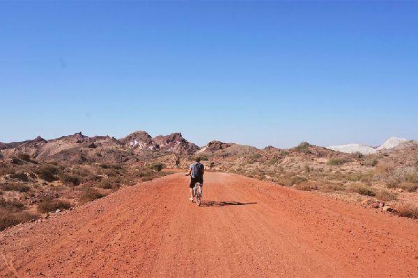 A traveler biking in Hormuz Island