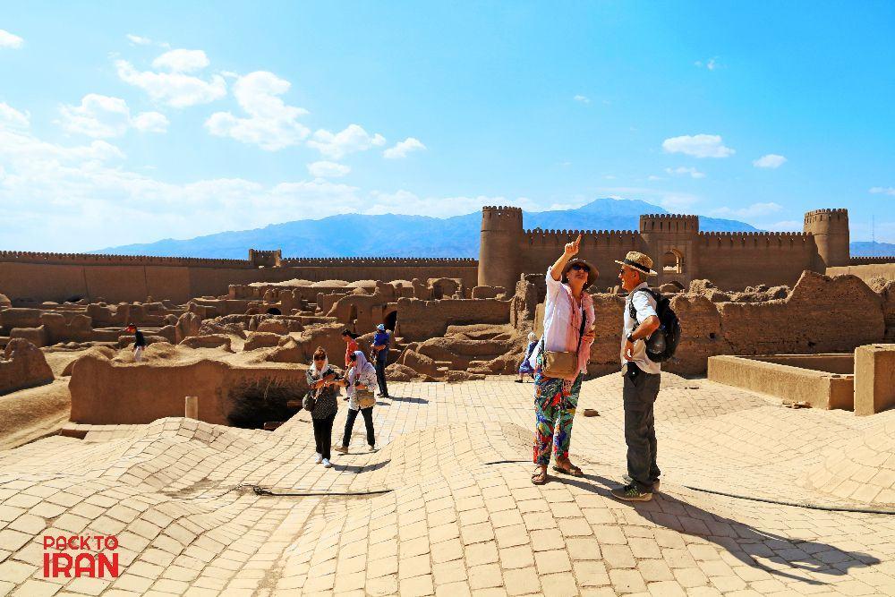 Travelers visiting Rayen Castle- Kerman, Iran