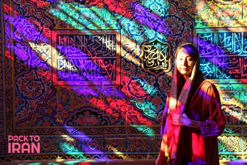 A woman standing in Nasir al Molk Mosque - Shiraz, Iran