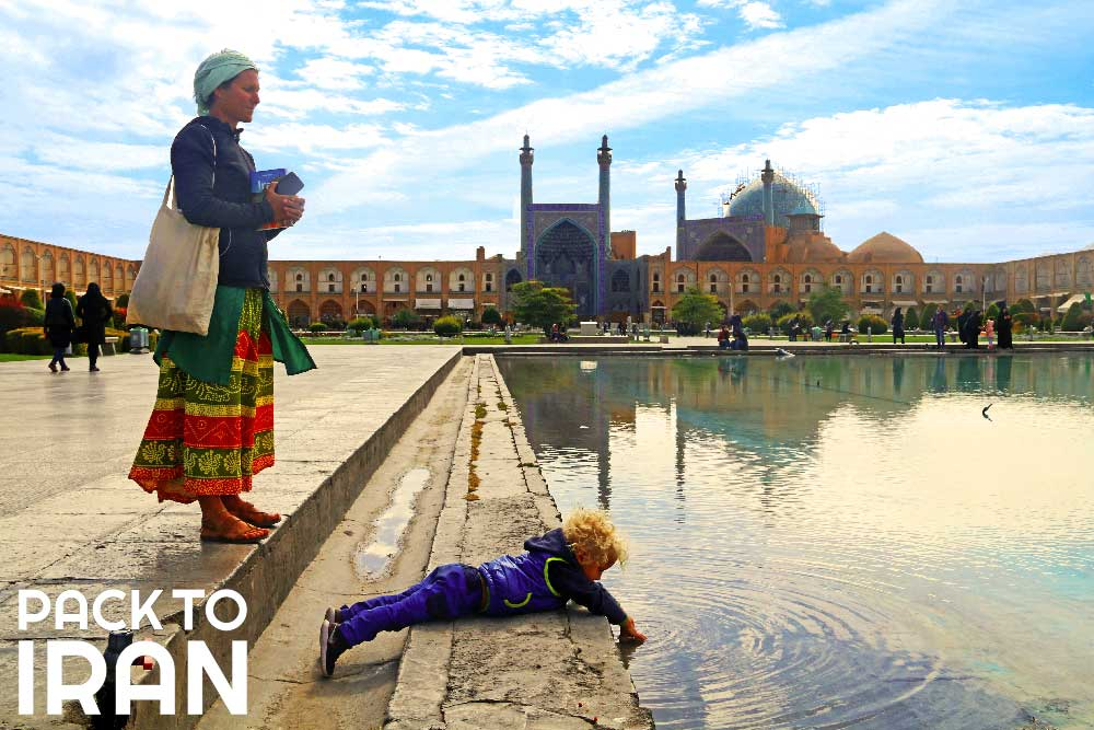 A woman and her son in Naqsh-e Jahan Square - Isfahan, Iran