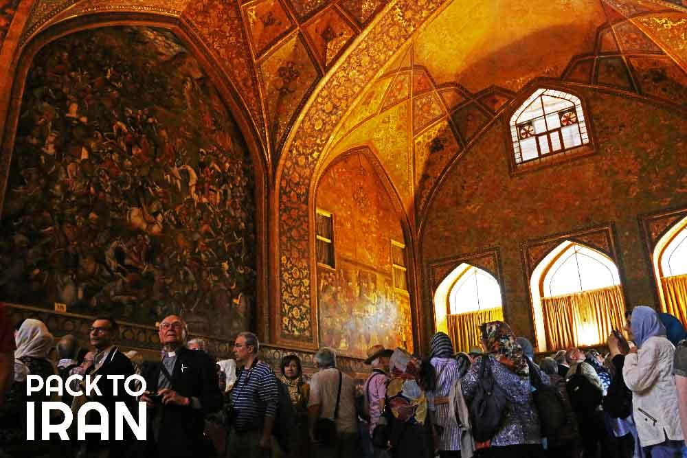 Travelers visiting Chehel Sotun Palace - Isfahan, Iran