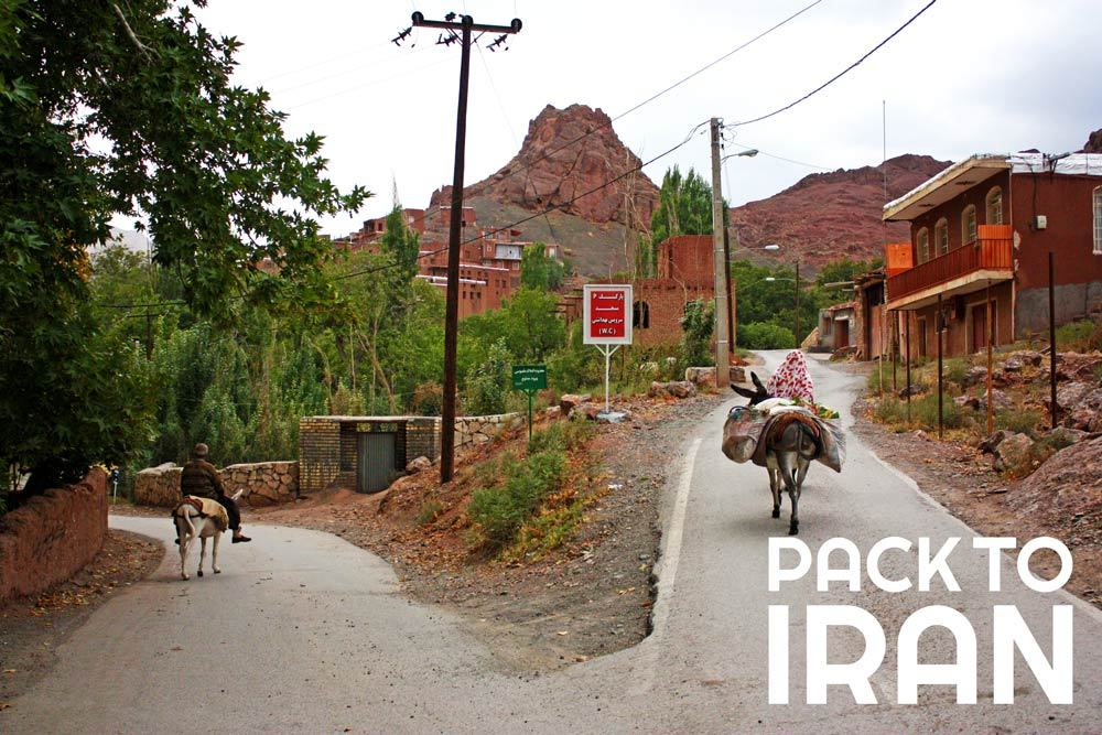 Locals riding mules in Abyaneh Village