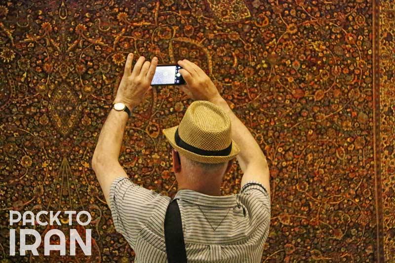 A traveler visiting Carpet Museum of Iran, Tehran