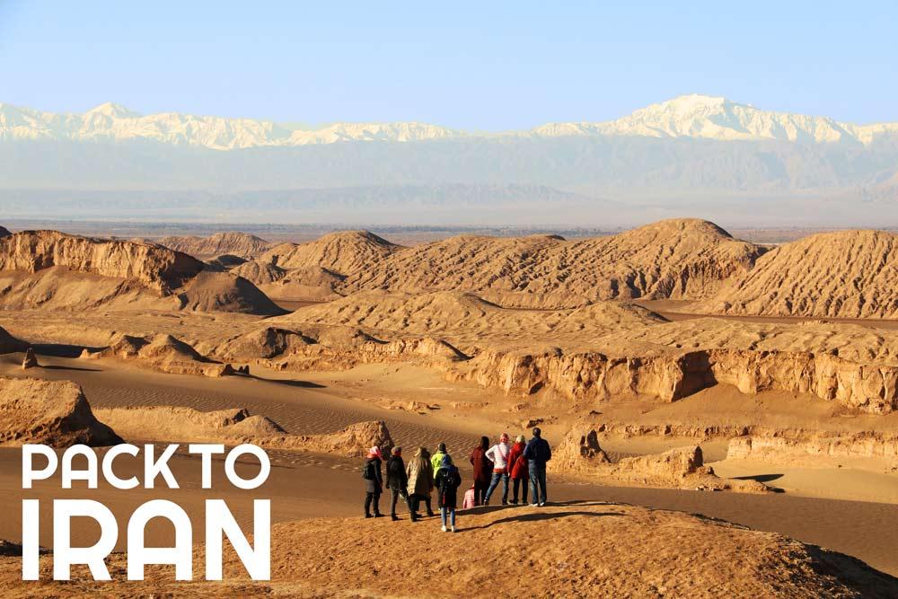 Travelers visiting Shahdad Desert - Iran