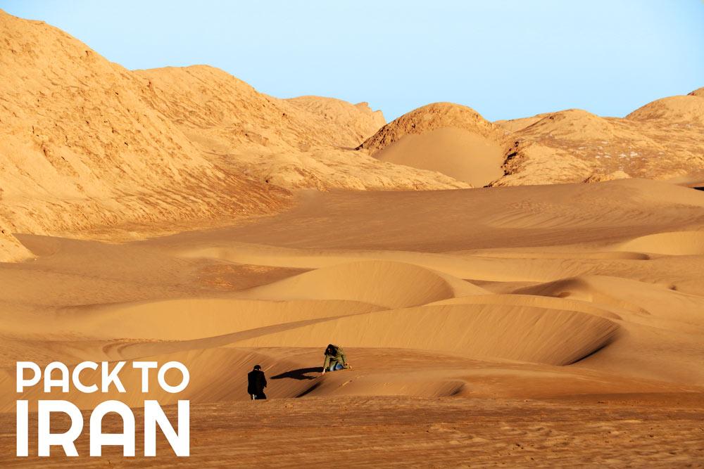 travelers exploring Lut Desert - Kerman, Iran