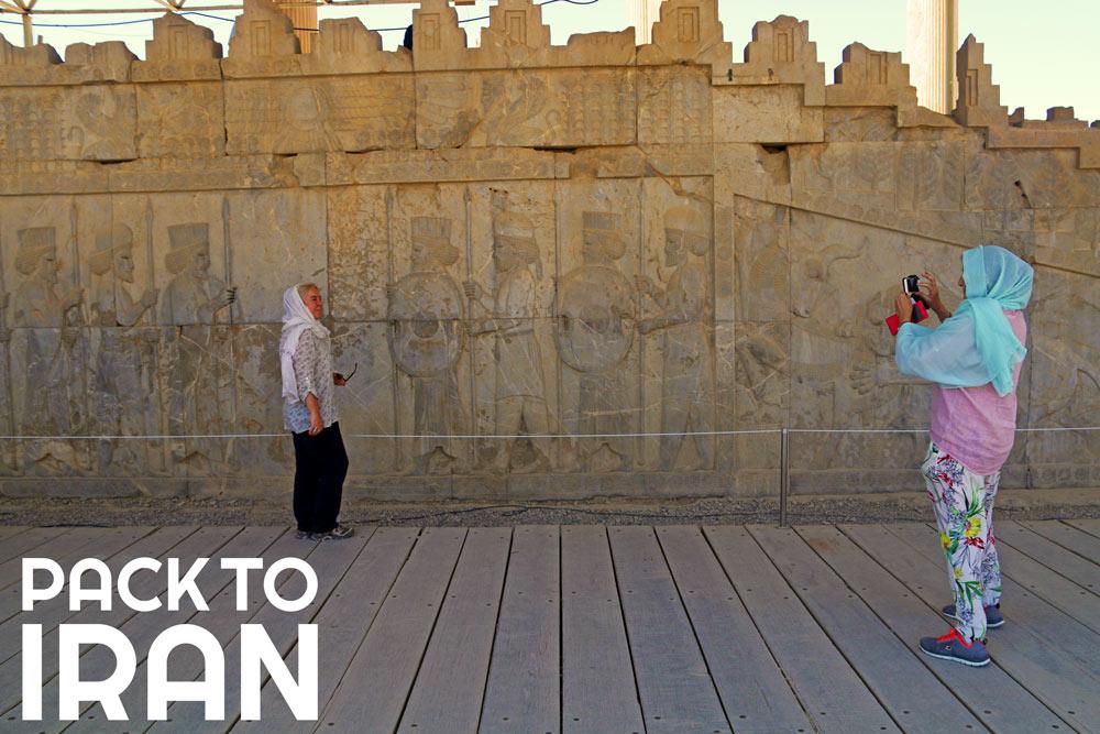 travelers taking photo at Persepolis