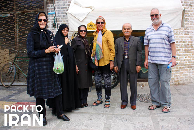 Travelers and locals in Iran